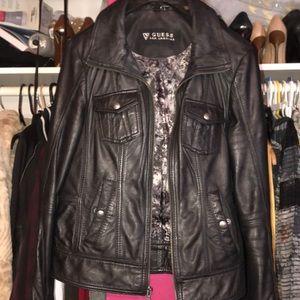 Black leather jacket with grey lining.